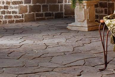 Is flagstone more expensive than pavers?